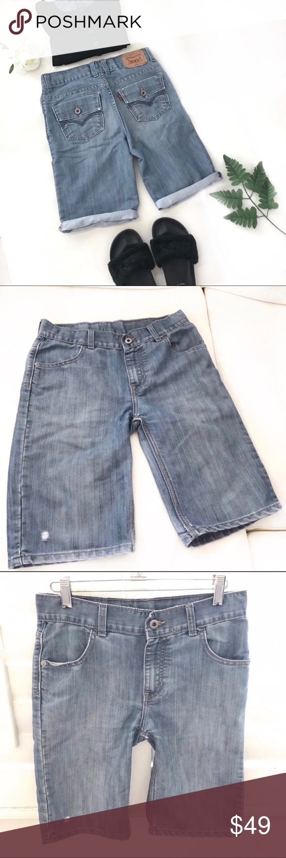 """LEVI'S bermuda shorts size 24 A cross between pants and cutoff jean shorts. Slightly distressed denim. Great for everyday or weekend. Vintage classic feel! Gigi Hadid wears her own similar version a little longer.  54% cotton, 45% polyester   Waist 24"""" Rise 9"""" Inseam 10"""" Levi's Shorts Jean Shorts"""
