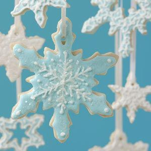 Snowflake Cookies - Your cookie trays will twinkle with these festive snowflake cookies.
