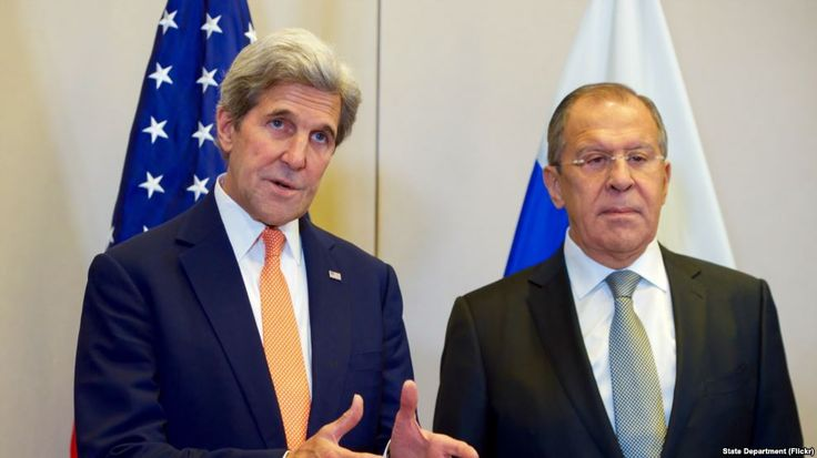 FILE - U.S. Secretary of State John Kerry, flanked by Russian Foreign Minister Sergey Lavrov, answers a reporter's question on Sept. 9, 2016, at the Hotel President Wilson in Geneva, Switzerland, before they begin a bilateral meeting focused on Syria.