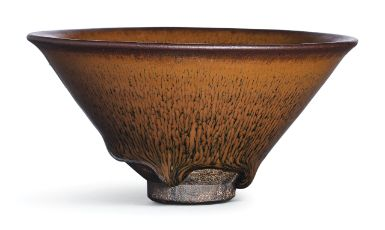A JIAN RUSSET-STREAKED 'NOGIME TEMMOKU' BOWL SOUTHERN SONG DYNASTY well potted with a conical body rising from a straight foot to a gently flared rim, unctuously covered with a lustrous black glaze with russet 'hare's fur' streaks running down from the rim, the glaze thinning at the rim and stopping short of the foot with three bulges and revealing the dark brown stoneware body 11.5 cm, 4 1/2  in.