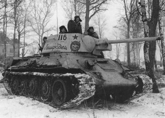 """Battle of Stalingrad, a T-34 mod 1942 Tank number 116 with """"Guards Roundel"""" in the depths of Soviet woods."""