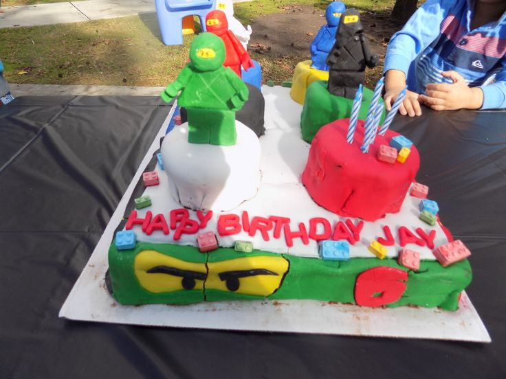 We ended up doing the cake ourselves.  A small lego-sized earthquake (i.e. the truck hit a bump) on the way to the park caused a crack down the middle of Lloyd's face (the green ninja).  But the kids never noticed!