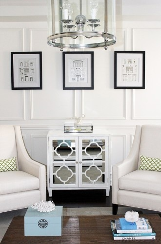 LOVE this simple mirrored table between the 2 chairs  The designer scored  this at a. 39 best Home Goods store images on Pinterest