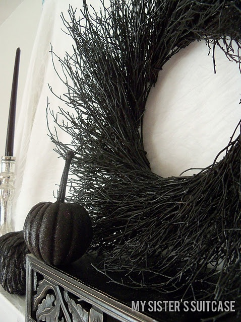 Spray paint a dollar store twig wreath black for Halloween