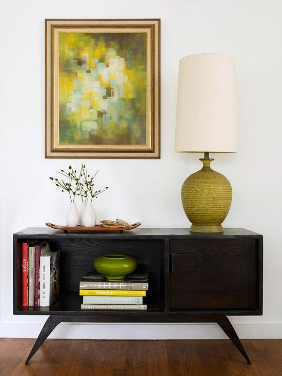 Love the repetition of the avocado color here in painting, lamp, vase.  Such nice design without being stuffy.