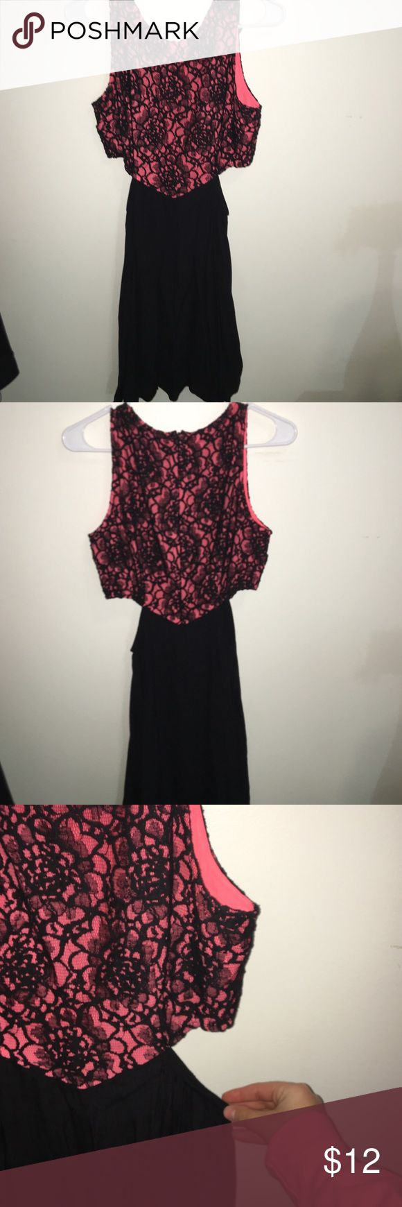Forever21 Dress with cutouts Has a more fitted top section with coral and black lace, there are symmetrical cut outs that lay right below where a bra would sit! the rest of the dress is flowy and sits right above the knee! it's super comfy ! Forever 21 Dresses Midi