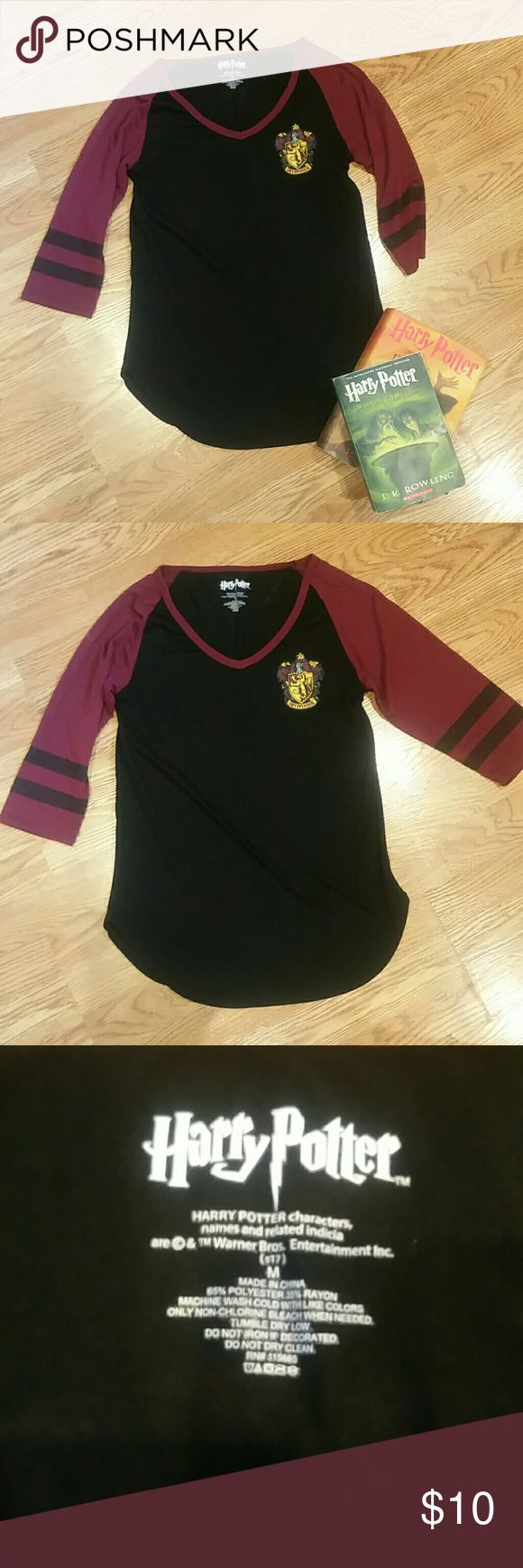 "Harry Potter Gryffindor T-shirt Maroon and black Harry Potter tee with Gryffindor House Seal. 3/4 sleeves. Garment is in like new condition, no holes or stains. Smoke-free, pet-free household.  Measurements  • Armpit to armpit 16.5"" • Sleeve 14"" • Length from the middle (longest part) 25.5"" unknown Tops"