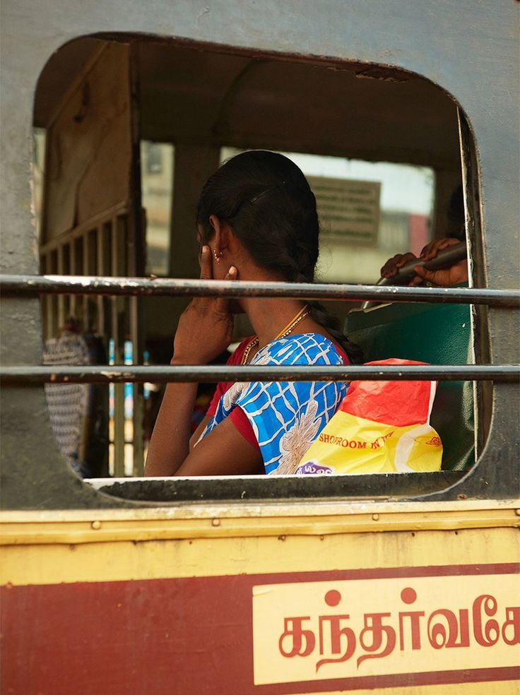 A young woman in a bus window near Pondicherry.