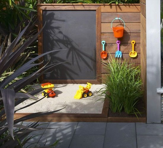 Modern sandbox and chalk wall.... This could be altered to be a stand alone unit. would put a space for toys/loose parts instead of garden though