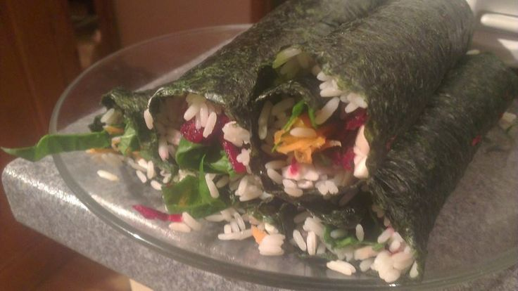 Nori wraps with rice (cooked with red onion, king oyster mushroom, grated ginger root and the juice of half a lemon) and fillings of chopped spinach and grated carrot and beet. Amazing <3