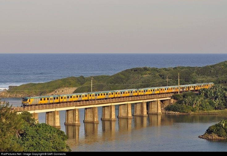 A Durban bound, Type 10M5 Metrorail set, catches the last of the winter afternoon sun as it crosses the Umgababa Bridge on the KwaZulu Natal South Coast. » Umgababa - KwaZulu Natal South Coast, South Africa