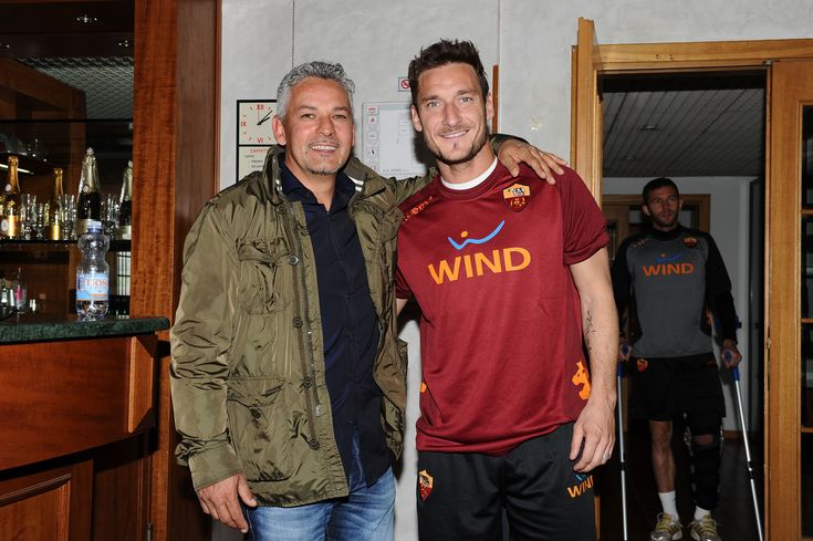 The bar at Trigoria training grounds is also a stage for history. Some of the greatest players in the world shared an espresso here with Roma legend Francesco Totti. Roberto Baggio doing the honors today.