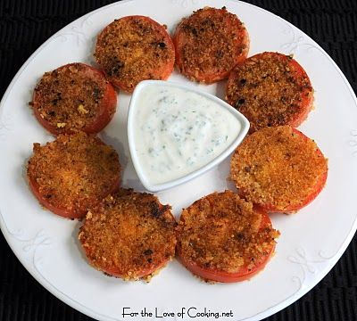 We've all heard of fried green tomatoes but my mother used to fry juicy red tomatoes on Sunday morning in the summertime. She would just use flour, salt & pepper to fry up till crispy but this recipe sounds like a good alternative to hers. It uses Panko bread crumbs and served up with a creamy basil dressing. My mouth is watering!
