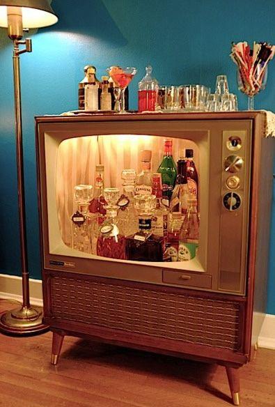 Vintage TV repurposed into a home bar.