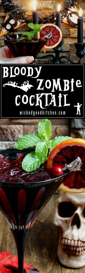 It's a Graveyard Smash! ~ This Halloween, treat yourself and friends to this wildly wicked cocktail created in the mold of the classic tropical Zombie Cocktail but with an autumnal and bloody twist. Blood orange, cranberry and pomegranate juices along with blood orange liqueur make for a euphoric rum sip. Your party guests will rave! | holiday cocktail recipe