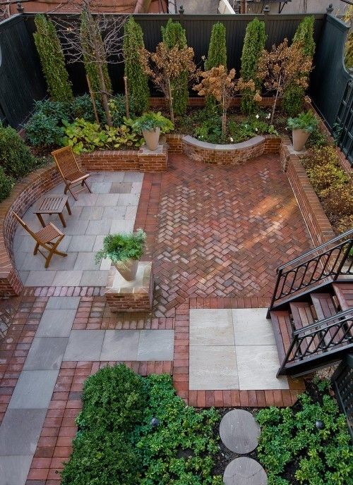 herringbone brick, contrasting grey pavers that act as space definers, garden edgers...great!