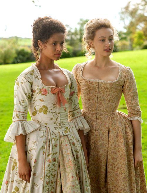 Gugu Mbatha-Raw as Dido Elizabeth Belle and Sarah Gadon as Lady Elizabeth Murray in Belle (2014).