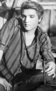 "Sometimes MISTAKENLY pinned as ""Young Elvis Presley"" or ""Elvis Presley - rare photo with his real hair color"".  Elvis was 28 when he played Jodie Tatum in ""Kissin' Cousins"", 1963. He's wearing a blonde wig in this photo."
