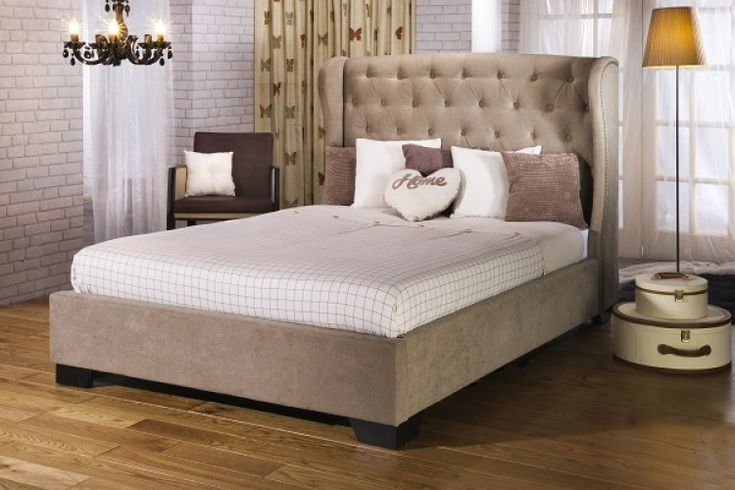 The Capella upholstered bed frame is a sumptuous bed frame in stone fabric. Add a touch of sophistication to your bedroom with this luxurious upholstered bed frame.