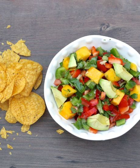 Simple & Delicious Mango-Avocado Salsa.   Except I would sub Jalapeno's for the bell peppers cuz I love it spicy!