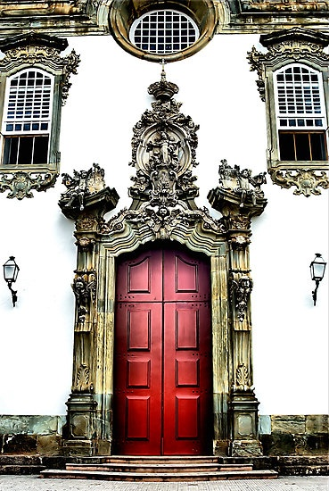 """I was told that one way to tell the status of a church in Sao Joao Del Rei, Brazil is by how ornate the main entry is. This entryway is one of the most ornate I found."" By Bob Wall on redbubble.com In this town of approximately 80,000, there are over 70 churches in town; from very small and plain, to large and ornate. This isn't the largest or fanciest church in town, but it is close."