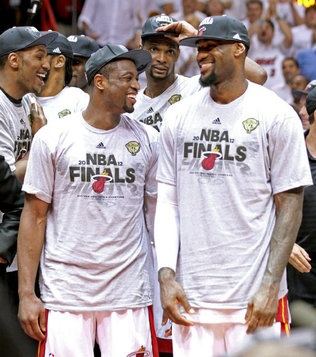 Dwyane Wade, Chris Bosh and LeBron James celebrate their win  during Game 7 of the NBA Eastern Conference Finals between the Miami Heat and the Boston Celtics at the AmericanAirlines Arena on Saturday, June 9, 2012.
