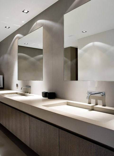 Sleek bathroom in neutral tones with extra large sinks in corian _