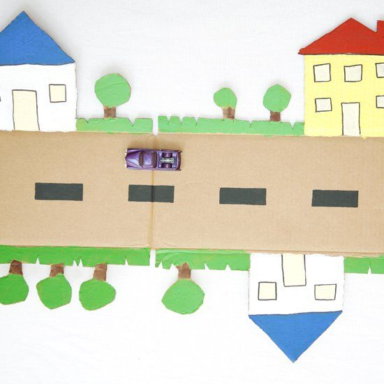 Make a colorful cardboard road for kids out of a box in just 3 easy steps.
