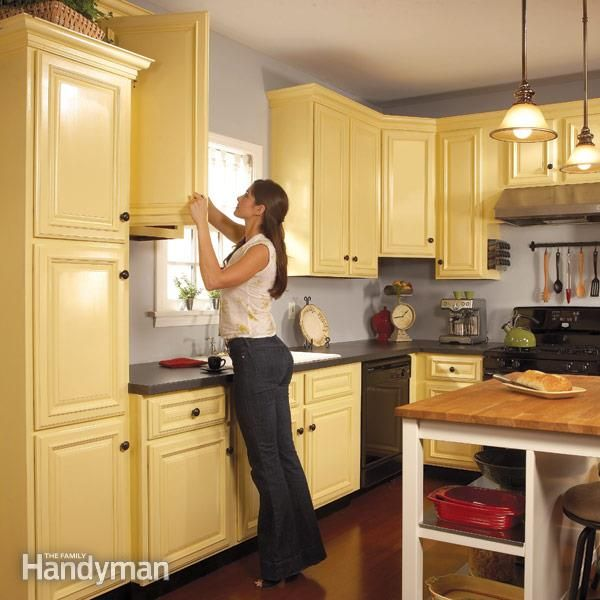 instead of replacing your old kitchen cabinets, make them new by repainting them. with an inexpensive paint sprayer and a few gallons of paint you can transform your kitchen in a weekend.