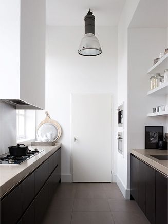 love everything about this kitchen the dark wood vs concrete look top and white walls designed by my favourite designer Natasja Molenaar