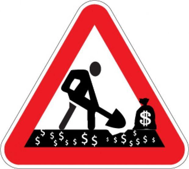 """Дорожный знак: """"Внимание: дерибан на дорожном ремонте!"""""""