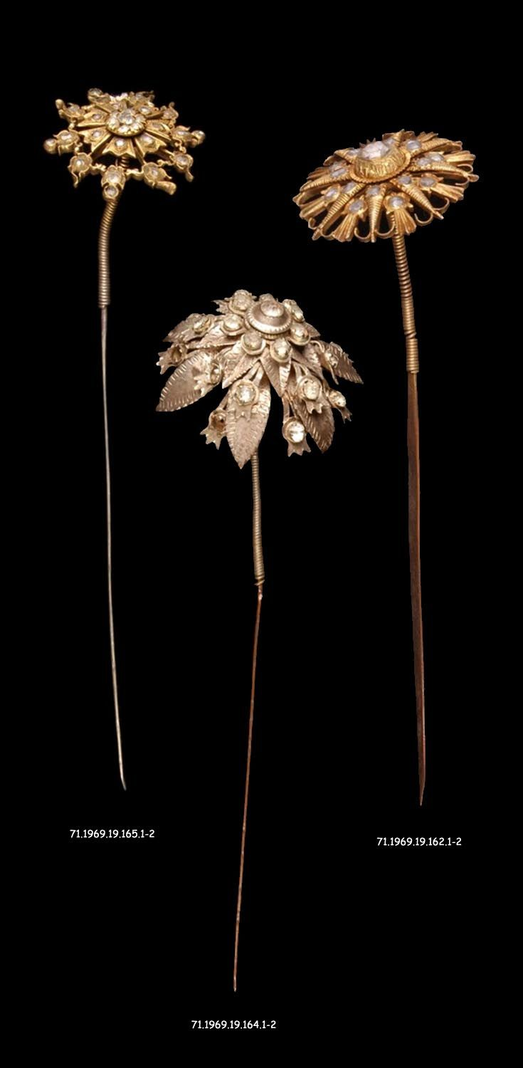 Indonesia - Java Island, Jakarta | Three hair pins from a headdress of a Orang Betawi bride; silver, gilt silver, glass. // ©Quai Branly Museum.