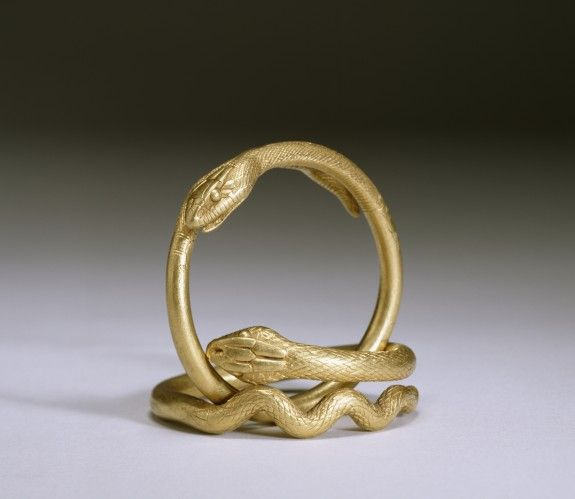 In the ancient Greek and Roman world, snakes symbolized fertility and were believed to ward off evil. It is probably due to the animal's protective associations that solid gold snake rings and bracelets were among the most popular types of Greek and Roman jewelry. Snake bracelets were often worn in pairs, around the wrists as well as on the upper arms.