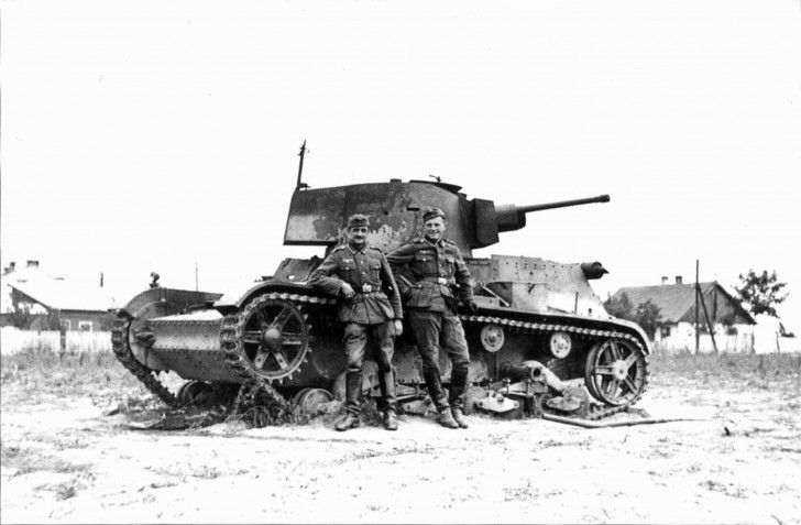 German soldiers against destroy 7TP. Light tank of the II world war was one of the basic armored vehicles in the polish army during The September Campaign in 1939.