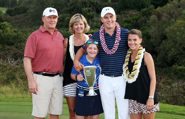 Jordan Spieth poses on the 18th green with his mom Chris, father Shawn, sister Ellie and girlfriend Annie Verret after winning the final round of the Hyundai Tournament of Champions at the Plantation Course at Kapalua Golf Club on January 10, 2016 in Lahaina, Hawaii.
