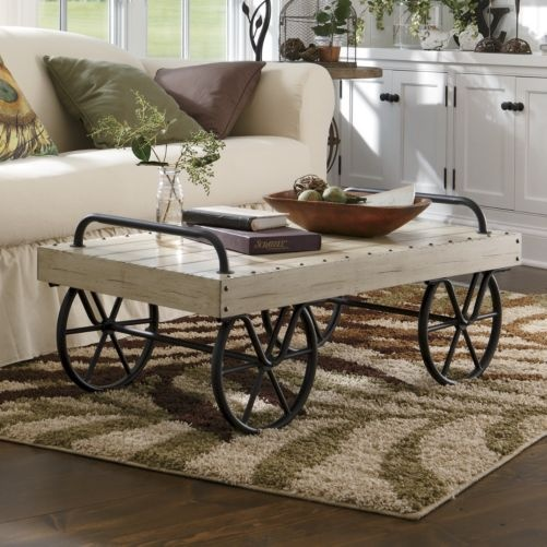 Farmhouse   Crafted In The Style Of A Baggage Cart, The Leeds Coffee Table  Is Realistically Detailed With A Metal Undercarriage, Handles And  Stationary ...
