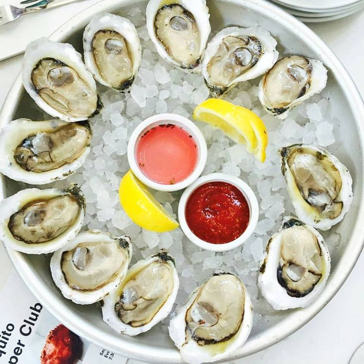 Posting up shop inside the lively St. Roch Market of New Orleans, Curious Oyster Co. offers diners a taste of the Gulf, West, and East coasts from its raw oyster menu.