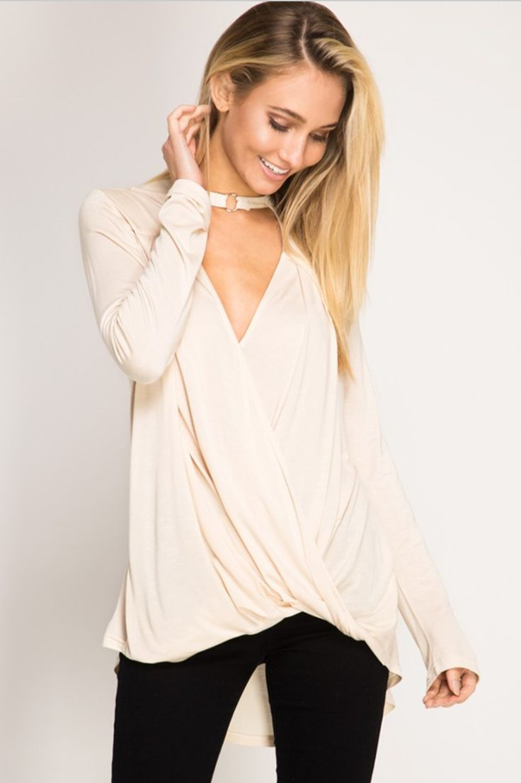 "Current mood? Obsessed with surplice tops. We love this ""Icon"" Surplice Top in Cream. Both feminine and flirty, it's a piece that can take you from day to night easily. We especially love it for dinner with your girlfriends! #loversleap"