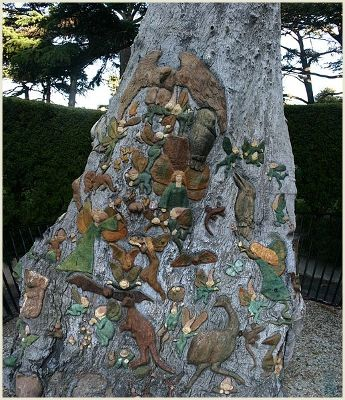 """""""Located in Melbourne, Australia, Fitzroy Gardens cover 26 acres first landscaped in the Victorian era. Amongst the various lovely features there is the Fairies Tree, a 300 year old Red Gum tree stump, around the base of which fairies and native Australian animals frolic. It was carved by Ola Cohn between 1931 and 1934, and in ... 'The Fairies Tree' she wrote """"I have carved in a tree in the Fitzroy Gardens for you, and the fairies, but mostly for the fairies and those who believe."""""""