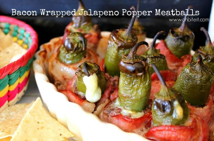Bacon Wrapped Jalapeno Popper Meatballs!  This spicy little meatball recipe is just a classic case of one thing leading to another... in a delicious way!   It started out as a meatball, but needed some kick, so clearly it needed to be stuffed with a jalapeno, but, what is a jalapeno without cheese oozing out of it? So in went the cheese! And of course, it needed to be held together...so, DUH BACON!!