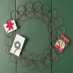 Wreath greeting card holder. I have a similar one to this. After the holidays, we put our mementos for the year on it...movie stubs, cards, photos, etc. It's fun to see it fill up as the year progresses.