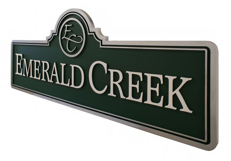 Subdivision entry signs by Strata Signage. Emerald Creek subdivision and community wanted two 10 foot long signs positioned at both entrances into their neighborhood. Routed with raised lettering for easy readability. www.customoutdoorwoodensigns.com