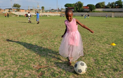 Young girl playing football in Brazil.  -blog.foreignpolicy.com