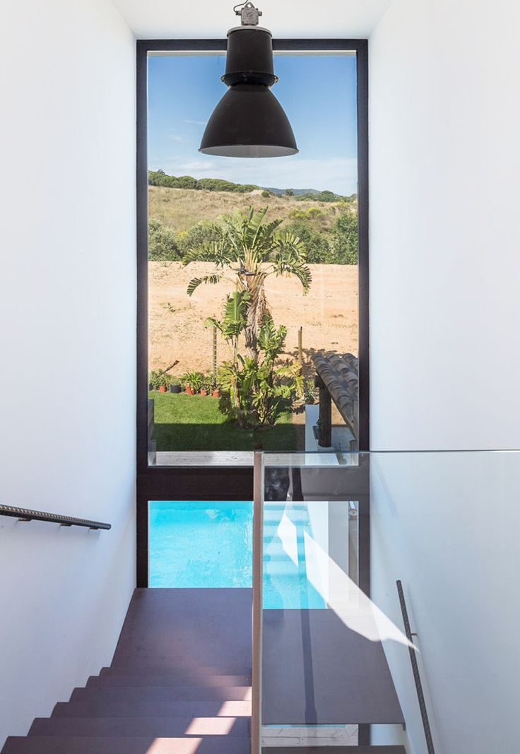 A House | 08023 Architects - Barcelona - Spain / View from the staircase. Window to the landscape. #stairs #windows #landscape