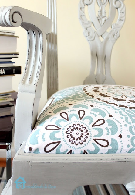 Recovering a chair seat - this was done using a shower curtain from Target, or could try using outdoor fabric