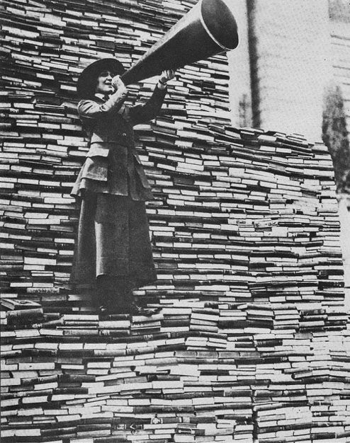"During World War I, the New York Public Library ran their ""War Library Book Drive"" with the slogan ""You! Help Build It."" To literally show the library being built, the books that were donated were stacked to form a monument on the front steps of the library… 1919"