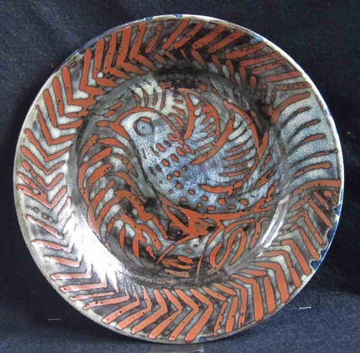 Wax resist, jun over tenmoku ash-glazed dinner plate.