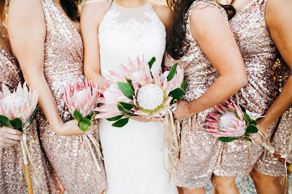 protea bouquets - photo by Catie Coyle Photography http://ruffledblog.com/gold-and-pink-vineyard-wedding