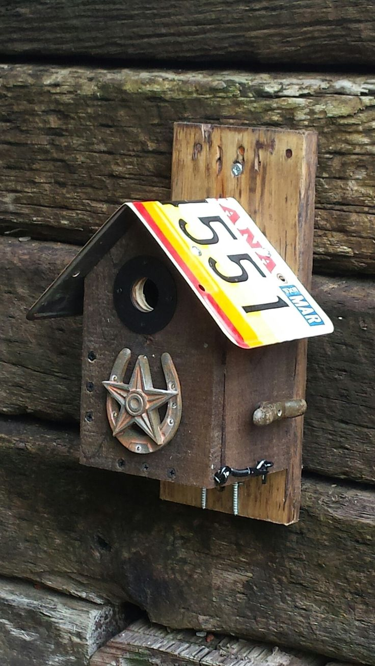 Recycled wood with 1981 Indiana license plate and rustic decorations. Carolina Wren and Chickadee birdhouse.