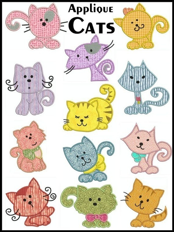 applique cats ...by embroiderquilt